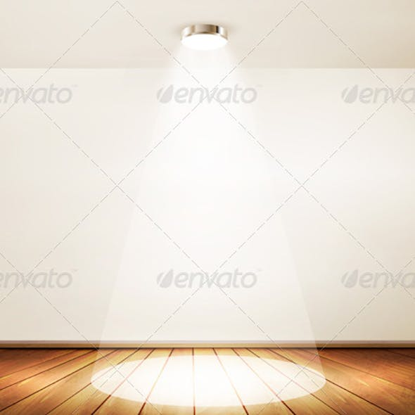 Wall with a spotlight and wooden floor