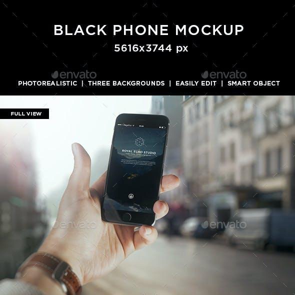 Hand Holding Black Phone 6 Mockup
