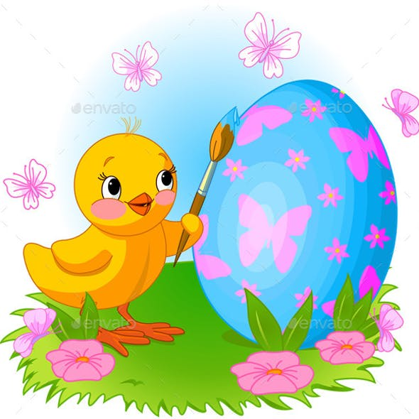 Chicken is Painting an Easter Egg