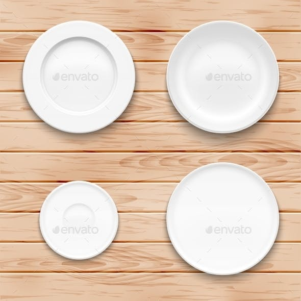 White Plate Set On Wooden Background