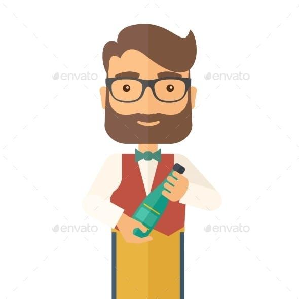 Wine Maker Holding a Bottle of Wine
