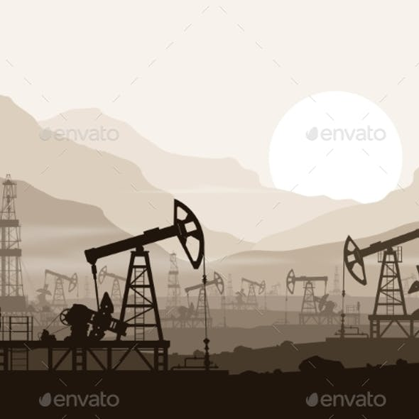 Oil Pumps and Rigs at Oilfield over Mountains