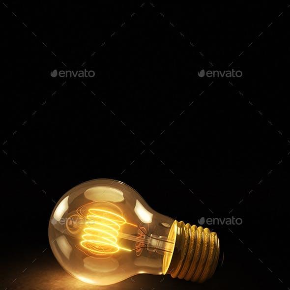 Glowing Incandescent Light Bulb on a Dark Backgrou