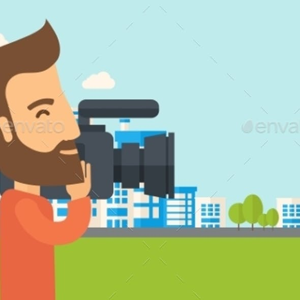 Cameraman With Video Camera