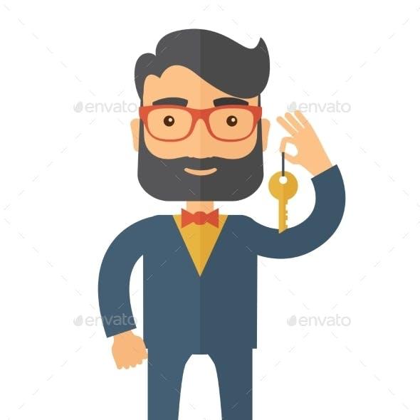 Business Man Holding a Golden Key.