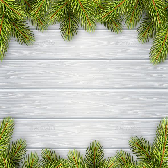 Pine Branches Frame on White Wooden Background