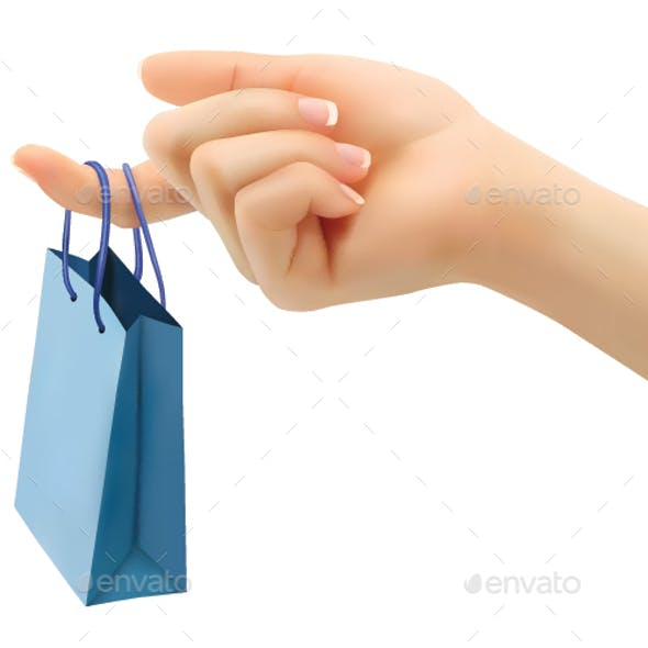 Female Hand Holding Shopping Bag