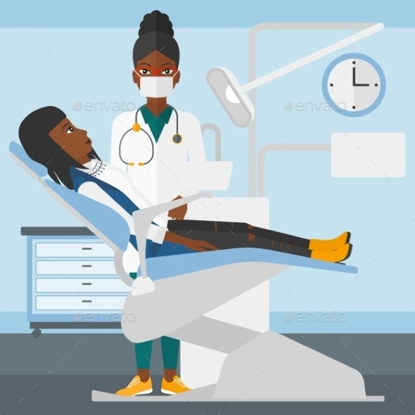 Dentist and Woman in Dentist Chair - Health/Medicine Conceptual