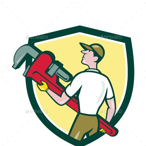 Plumber Carrying Monkey Wrench Crest Cartoon