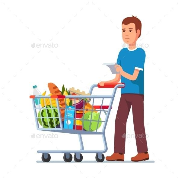 Young Man Pushing Supermarket Shopping Cart