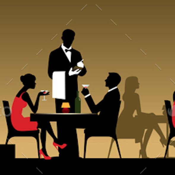 People in Night Club or Restaurant Sitting at a Table