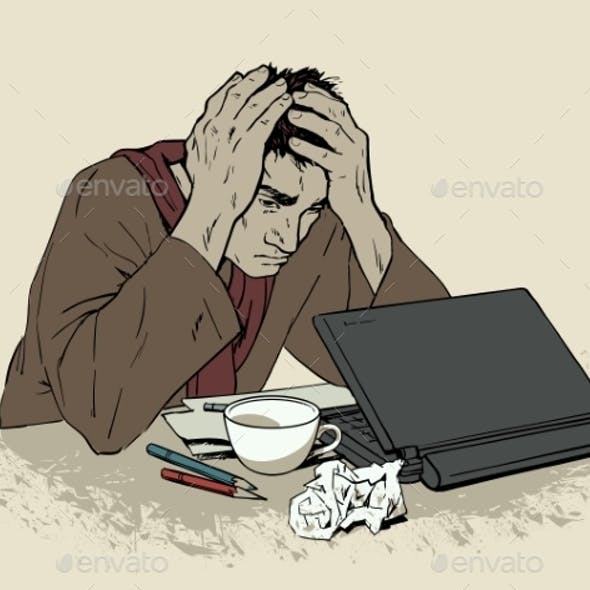Man in Despair Sitting at a Computer with Headache