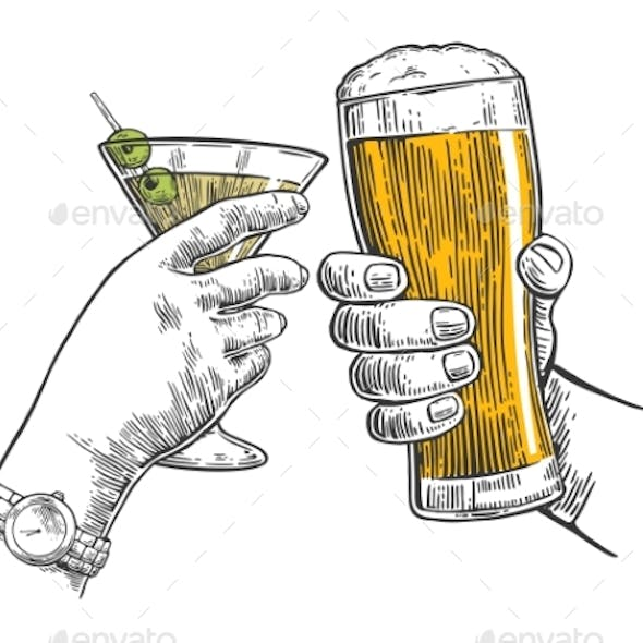 Two Hands Clink a Glass of Beer and a Martini