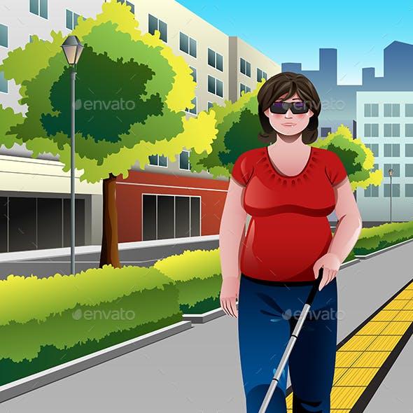 Blind People Walking on Sidewalk