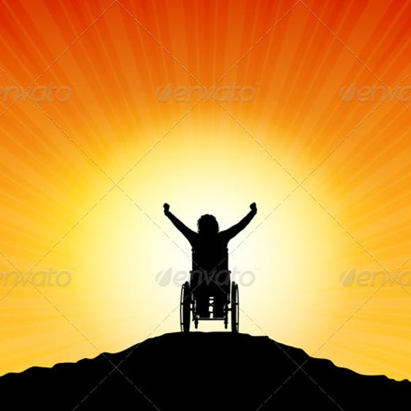Female in Wheelchair with Arms Raised