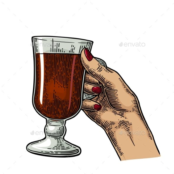 Female Hand Holding a Glass of Cocktail