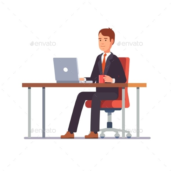 Business Man Working at His Office Desk