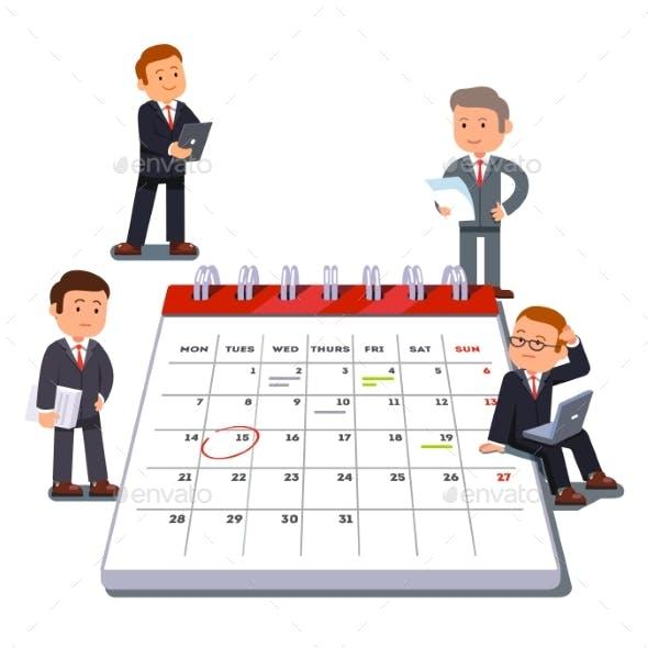 Company Business Team Planning on a Big Calendar