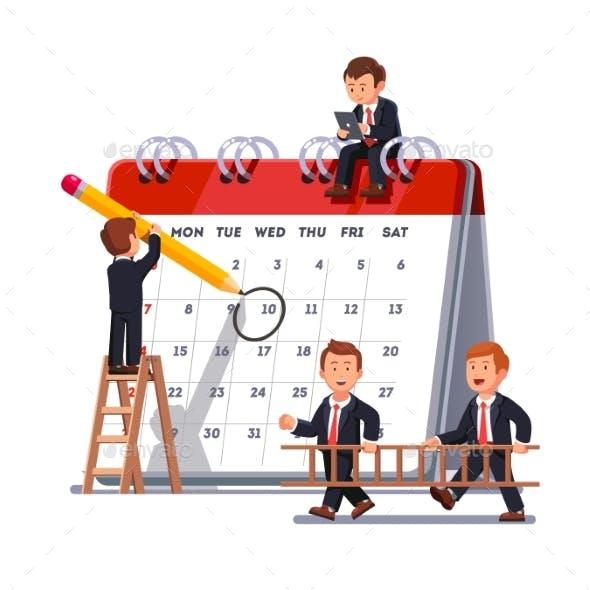 Business Team Planning Together on a Big Calendar
