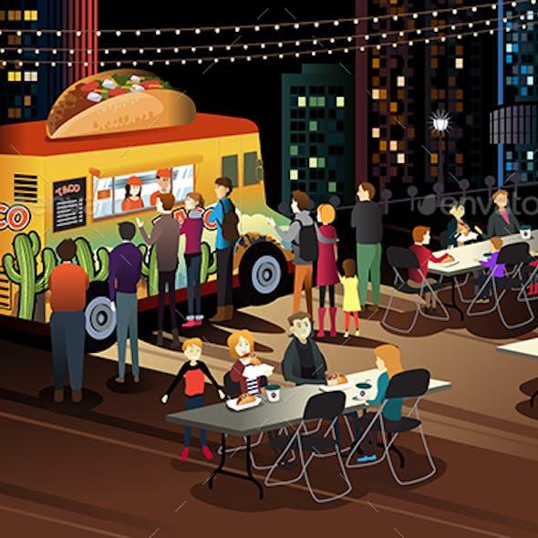 People Eating Taco at Taco Truck at Night