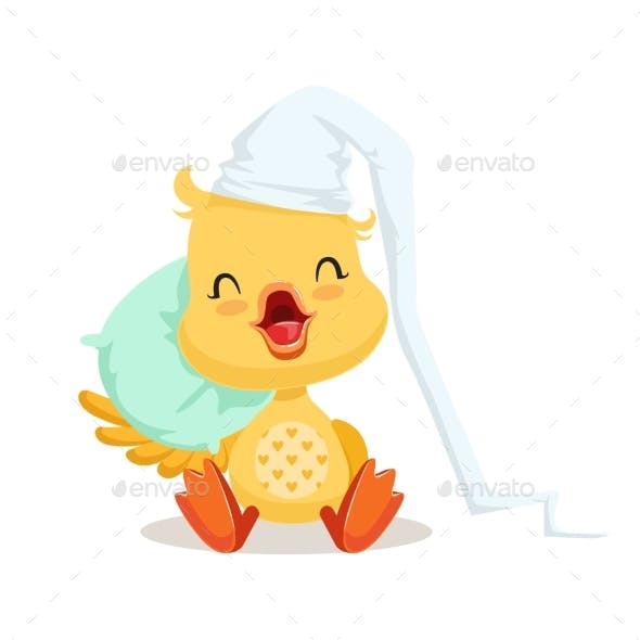 Sweet Yellow Duckling Sleeping on a Pillow