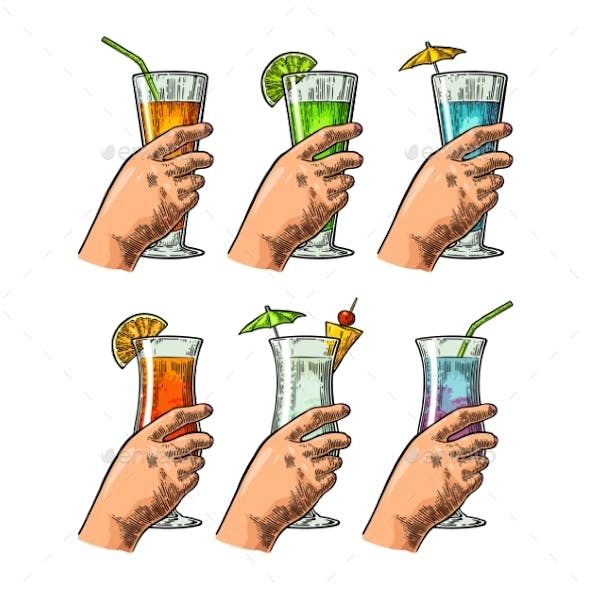 Female Hand Holding a Glasses of Cocktails
