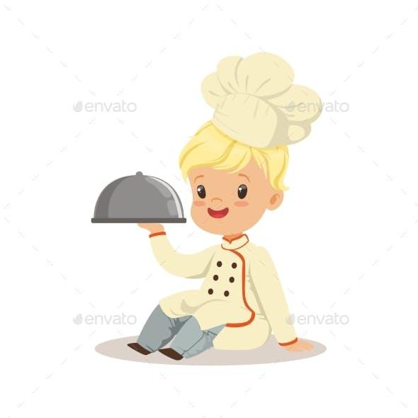 Boy Holding a Silver Cloche Food Platter