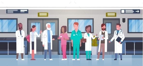 Group Of Doctors In Hospital Corridor Diverse - Health/Medicine Conceptual