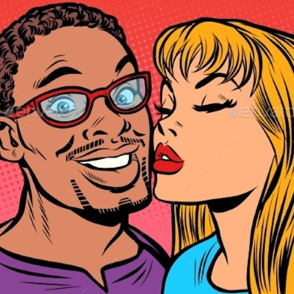 Woman Kisses a Man Multi-Ethnic Couple