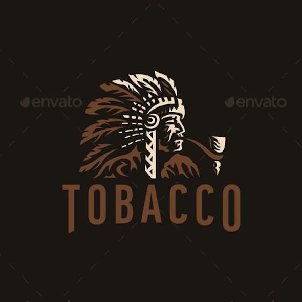 Native American Smokes a Pipe
