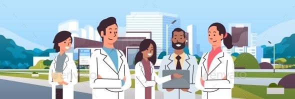 Group of Mix Race Doctors Team in Uniform Standing - Health/Medicine Conceptual