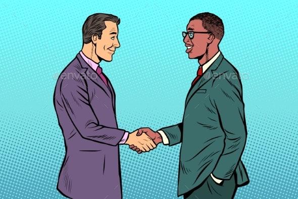 African and Caucasian Businessmen Men Handshake - Business Conceptual