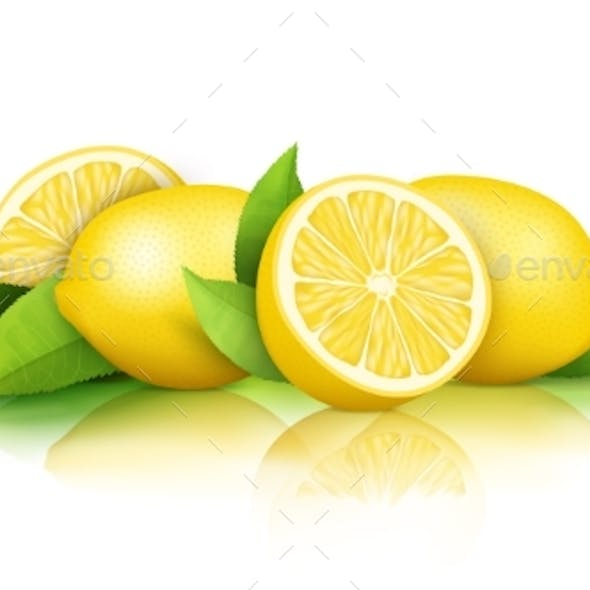 Lemons and Green Leaves Isolated on White