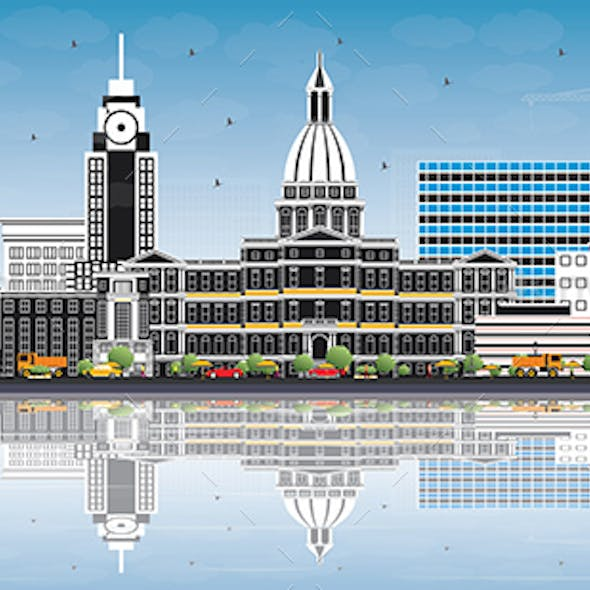 Lansing Michigan City Skyline with Color Buildings, Blue Sky and Reflections.