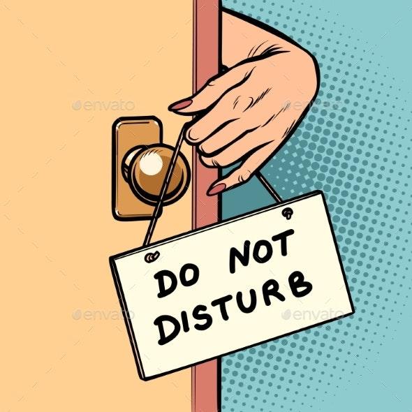 Do Not Disturb Woman Hand Hangs a Sign on the Door
