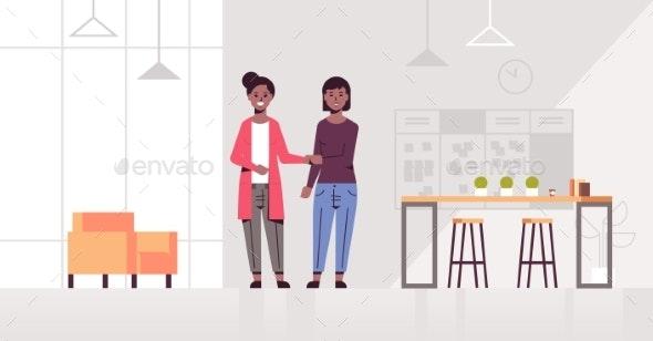 Businesswomen Handshaking - People Characters
