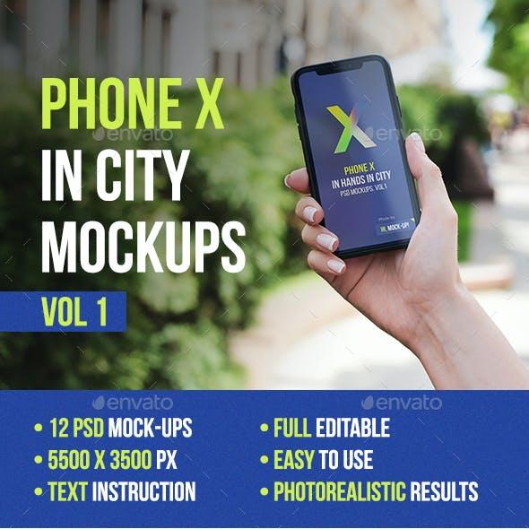 Phone X in Hands in City Mockups Vol1
