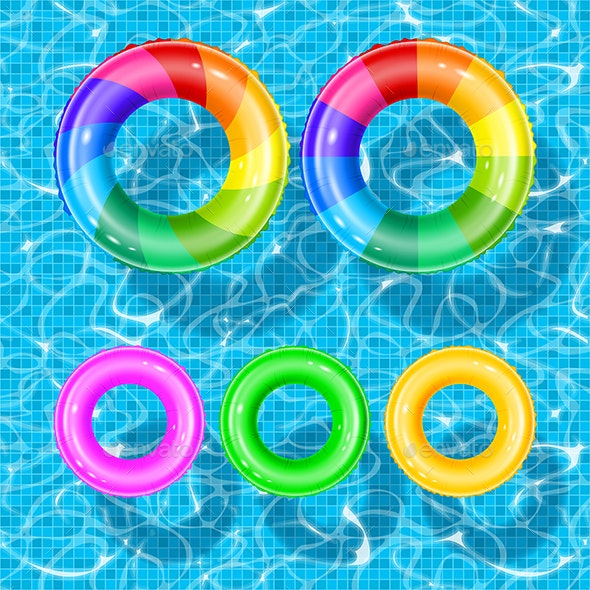 Inflatable Rings on Blue Water Background - Man-made Objects Objects