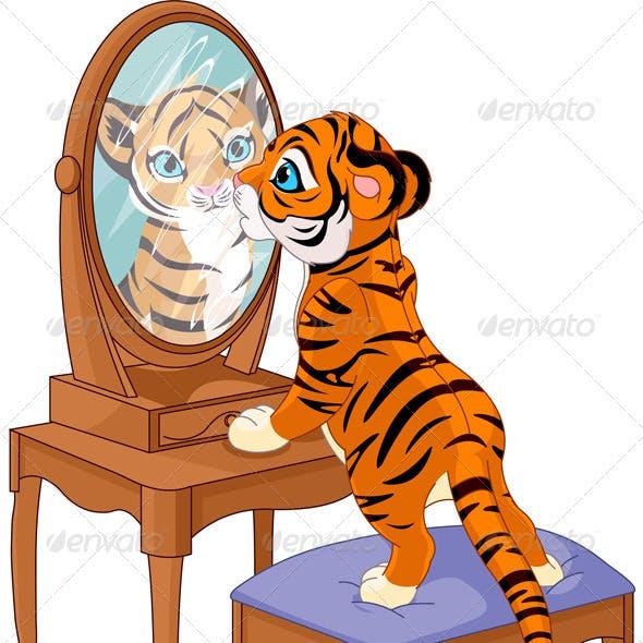 Tiger cub looking in the mirror