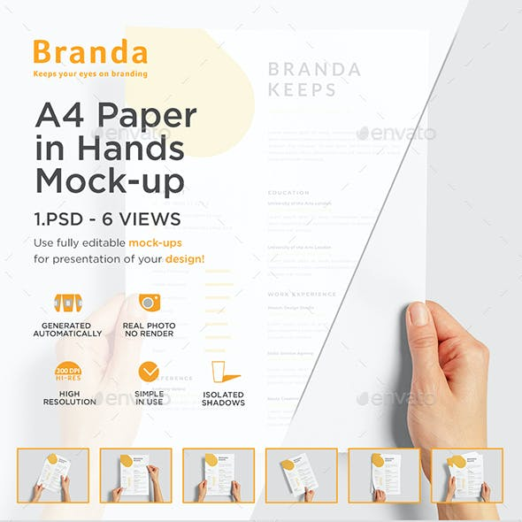 A4 Paper in Hands Mock-up