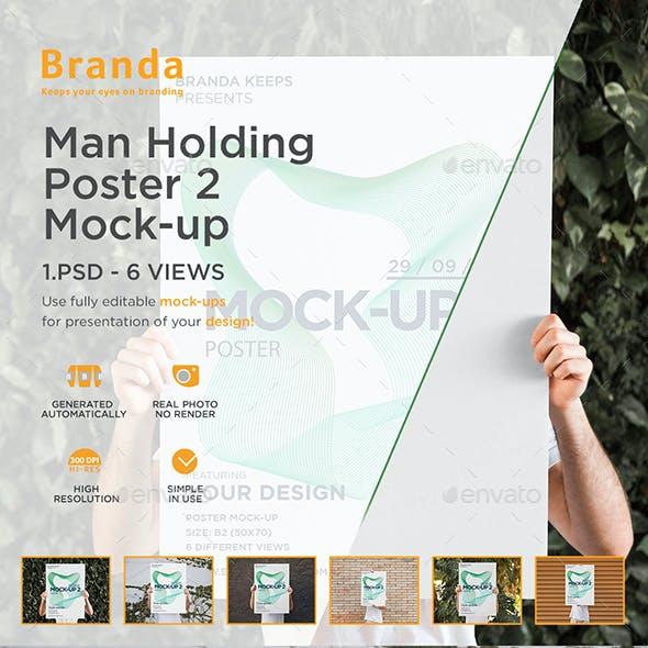 Man Holding Poster 2 Mock-up
