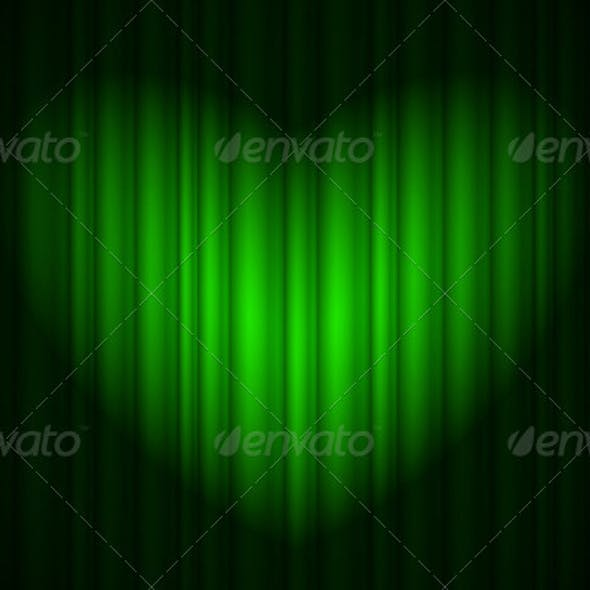 Stage with green curtain and spotlight