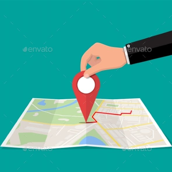 Location Pin in Hand and Paper Map