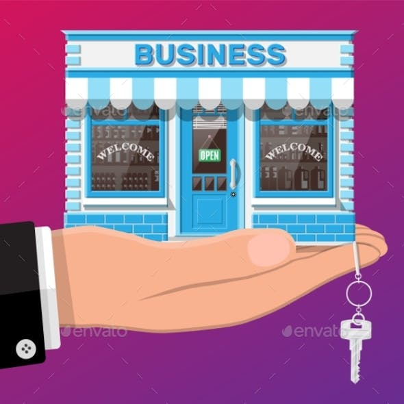 Hand Holding Shop or Commercial Property with Key.
