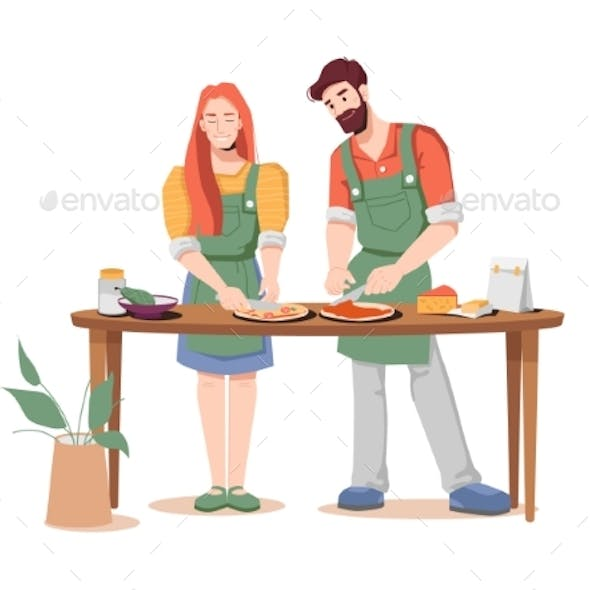 Couple Cooks Pizza Together at Table