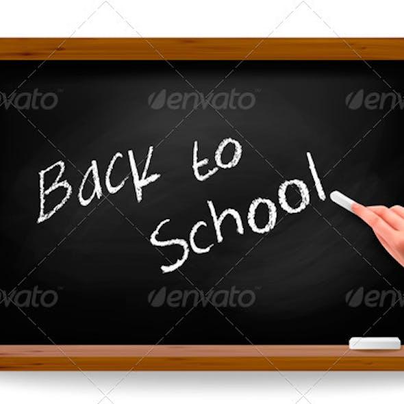 Back to school. Hand writing on a blackboard.