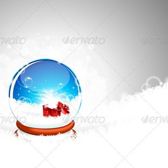 Snow globe against and magic gift box.