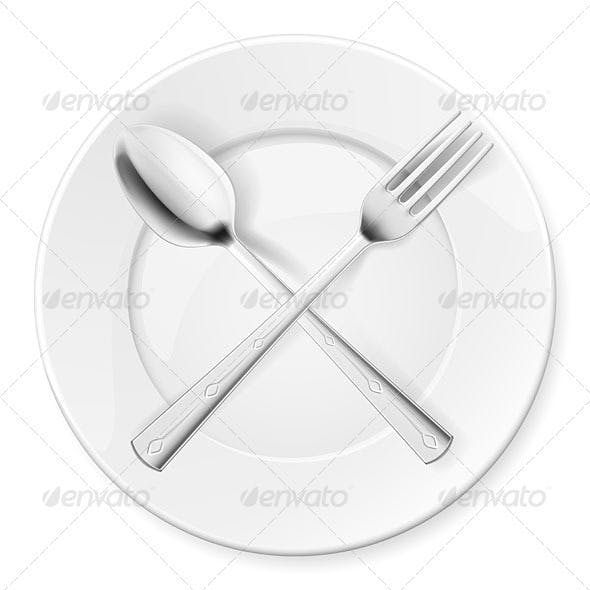 Spoon, fork and plate