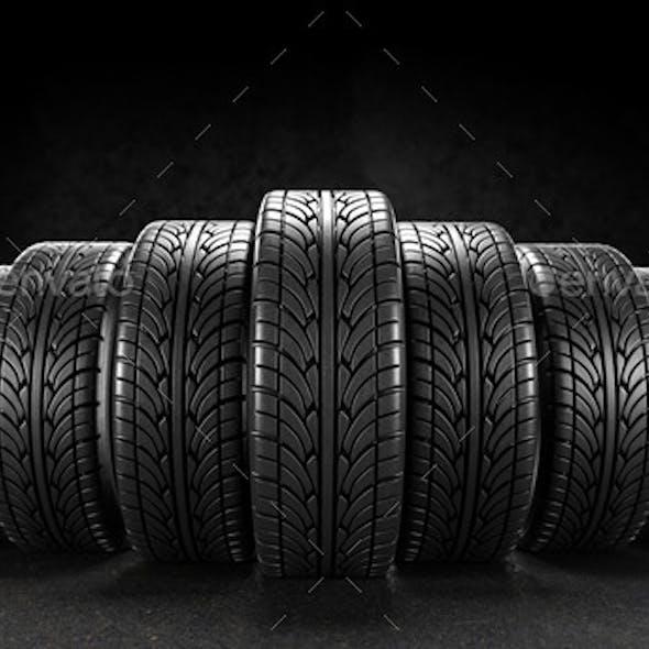 Seven Car Wheels on Black Background
