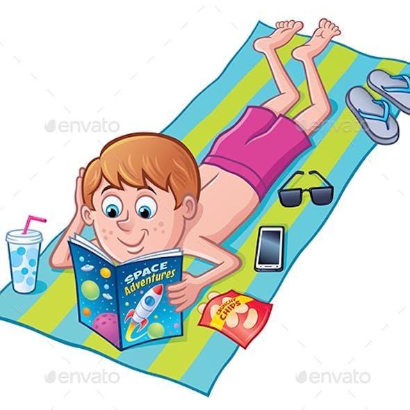 Boy Reading Comic Book On Beach Towel